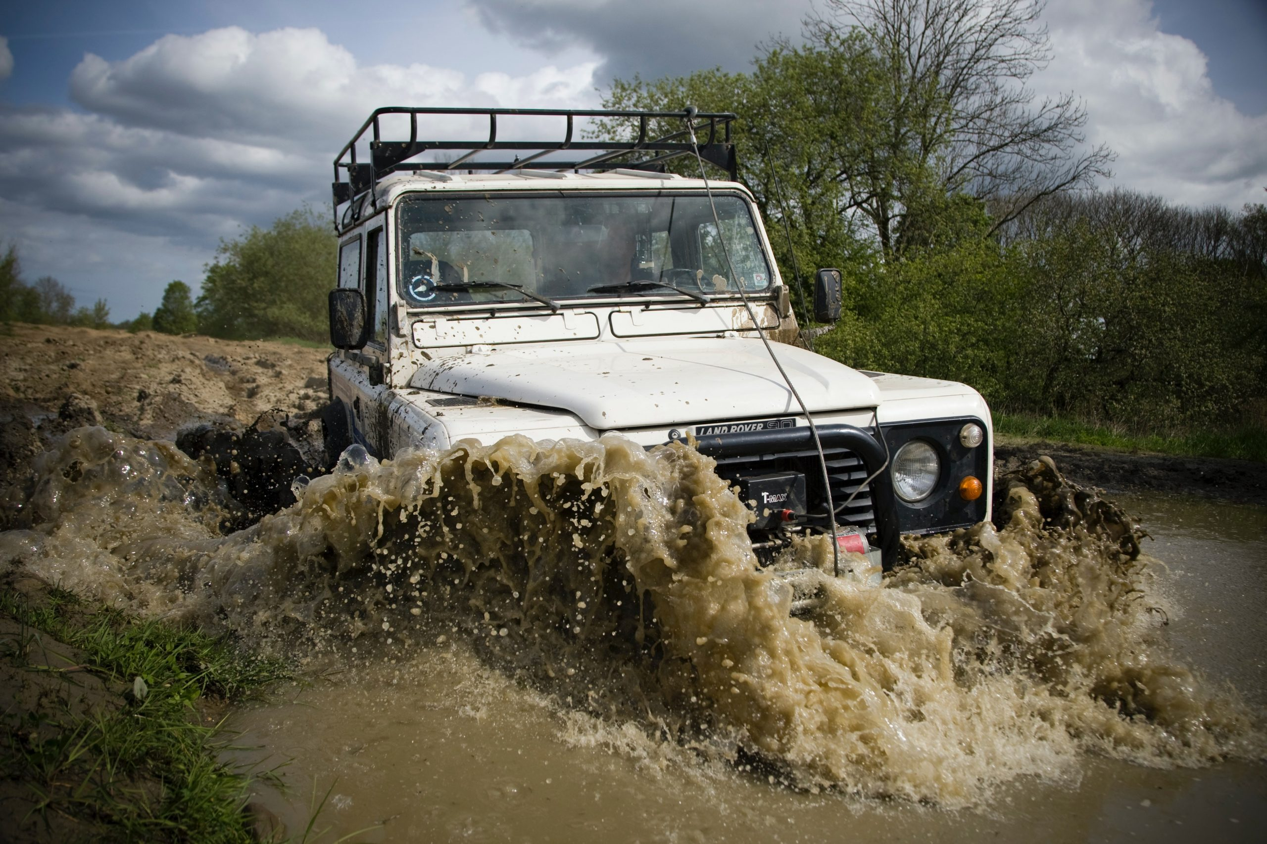Australia's Best Touring Locations - offroad vehicle driving through water