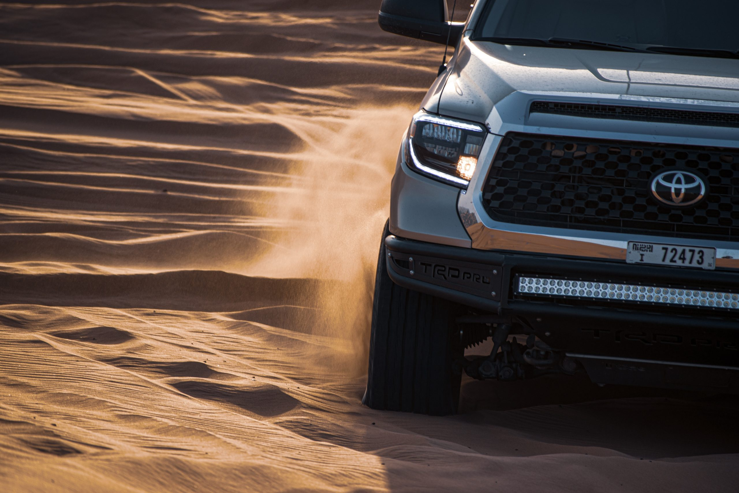 Toyota Hilux power upgrades - silver Toyota on sand