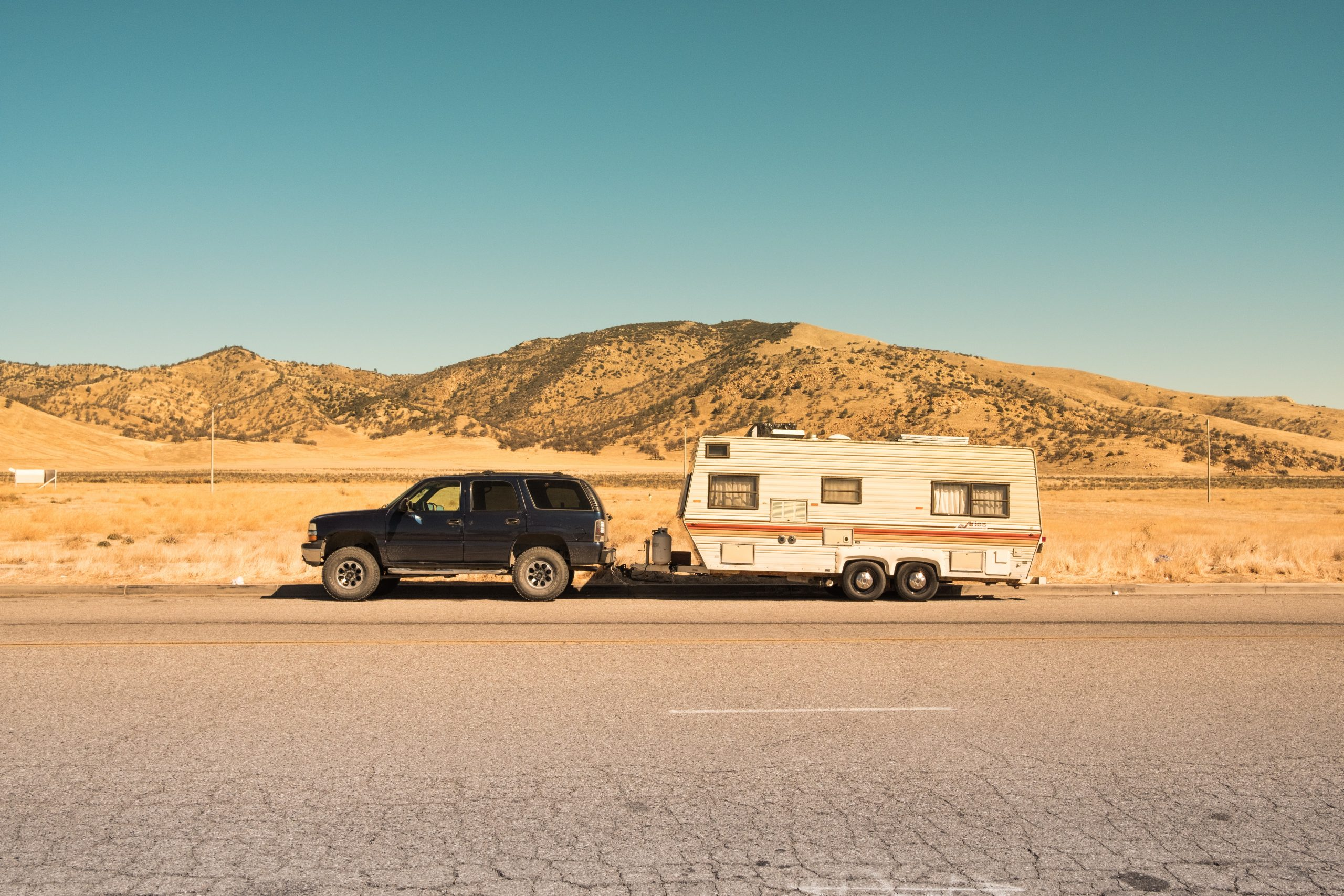 Towing A Trailer: Top Tips and Upgrade Opportunities - black SUV with caravan
