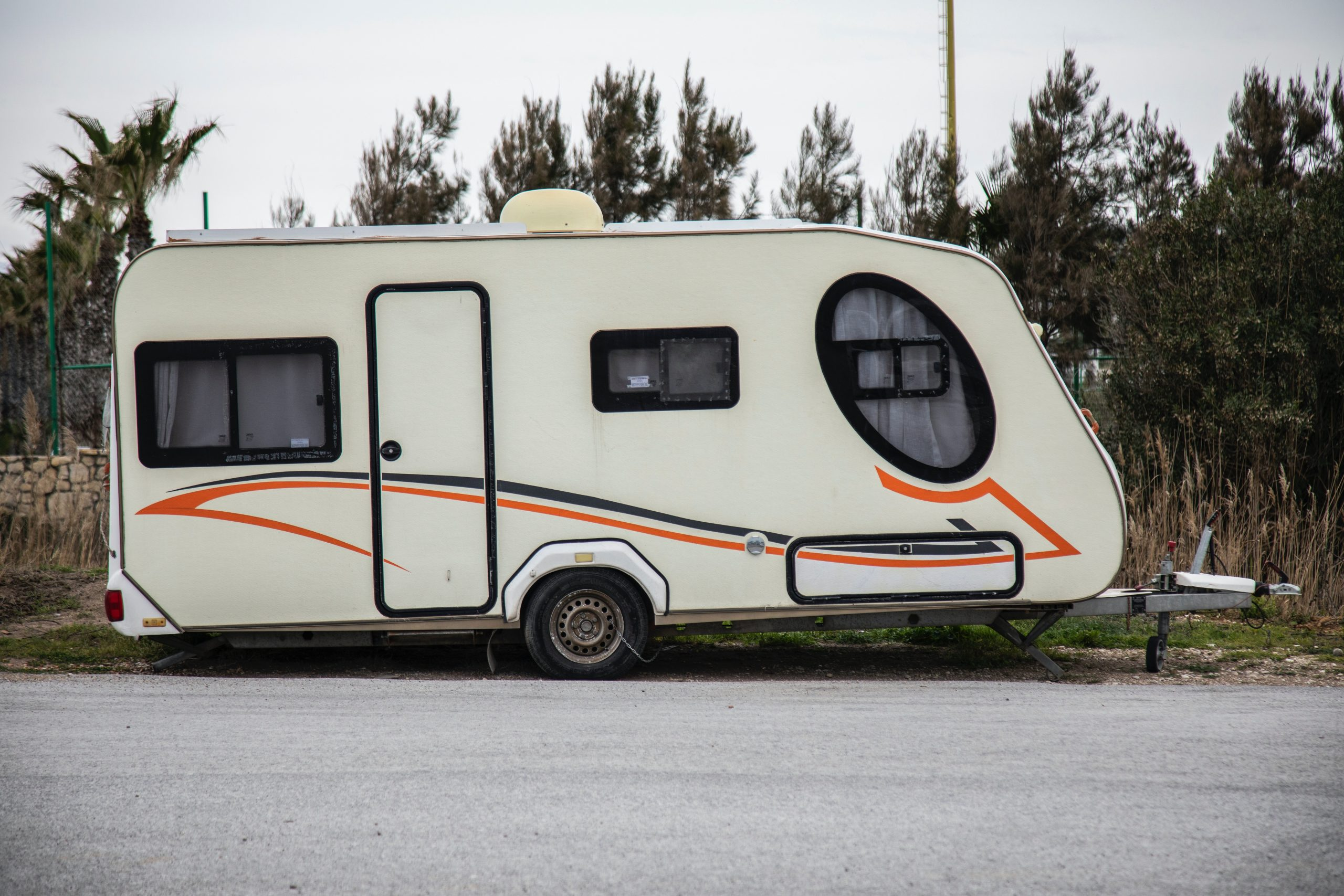 Towing A Trailer: Top Tips and Upgrade Opportunities - white caravan parked on side of the road
